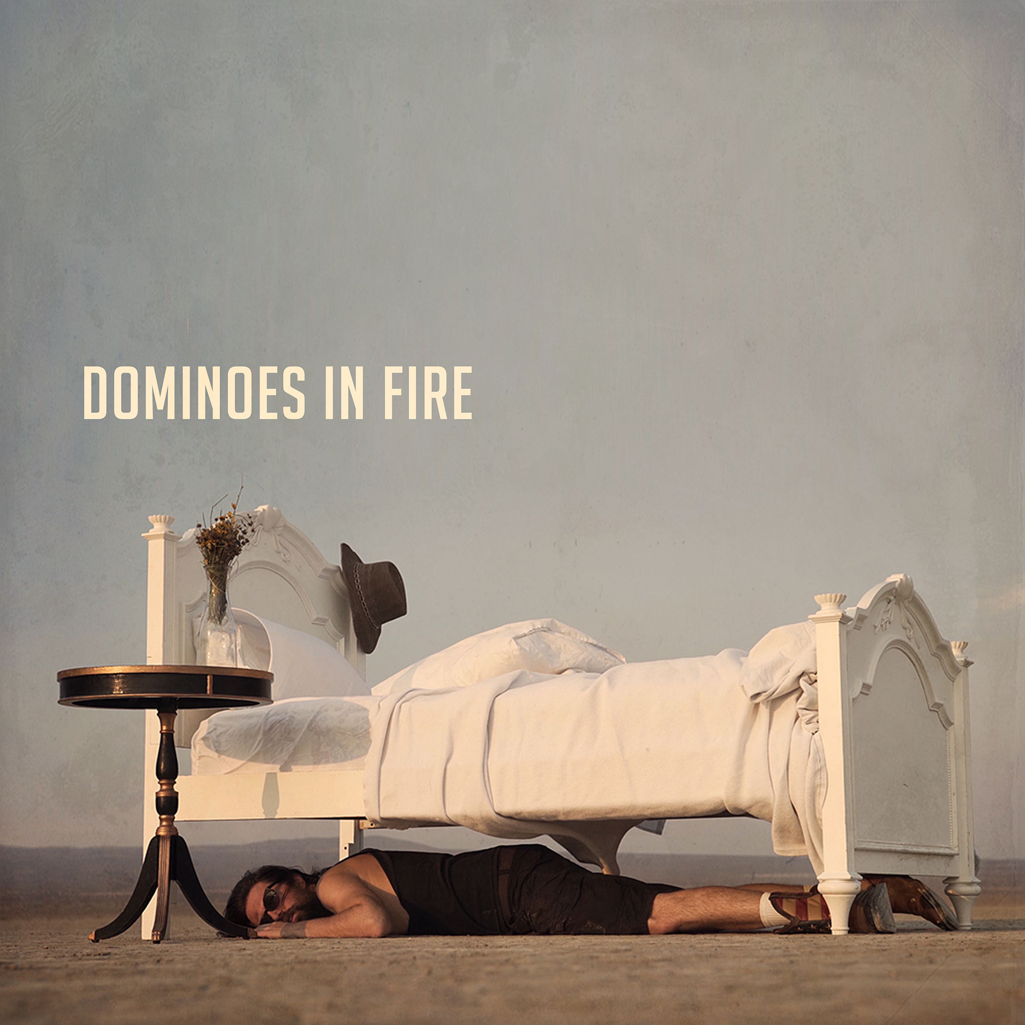 """""""Dominoes in Fire"""" is the fourth single (Release: 9.7.18) from Beard Bates' forthcoming album """"The World is Blown"""" (Nov 9, 2018). Music Video: Director: Beard Bates Director of Photography: Henrik Christofferson (Desert Scene) Director of Photography: Issac Alvarez (Poppy Field Scenes) Starring: Kelli Kickham & Beard Bates Song: Written, Performed and Produced by Beard Bates Mastered by Howie Weinberg Copyright and Published 2018 Studio Records Group America"""