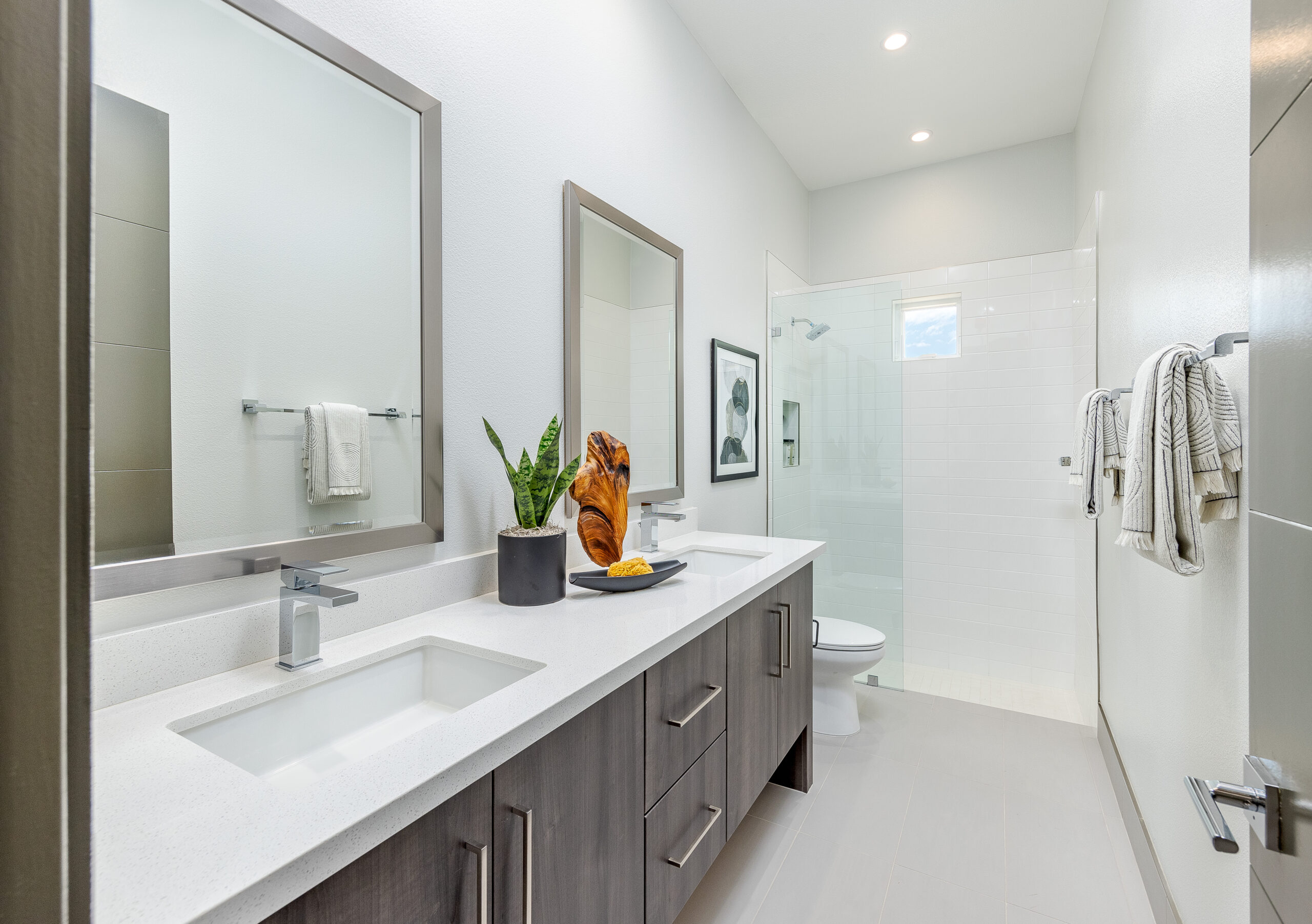 Residence 3: Bathroom with dual vanity and walk-in shower