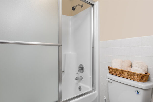 A shower and toilet at Chesterfield Village Apartments