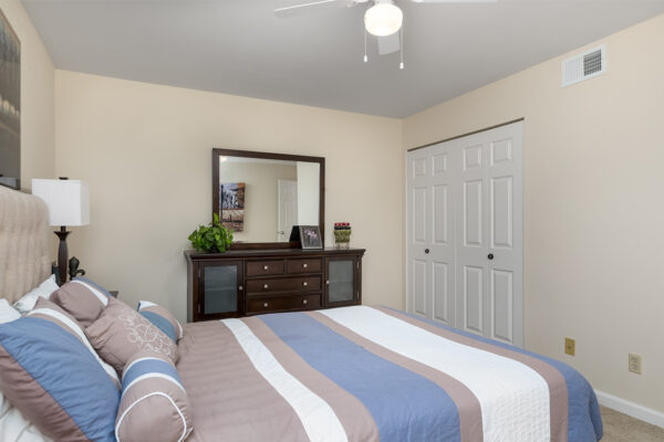 A bedroom and closets at Chesterfield Village Apartments