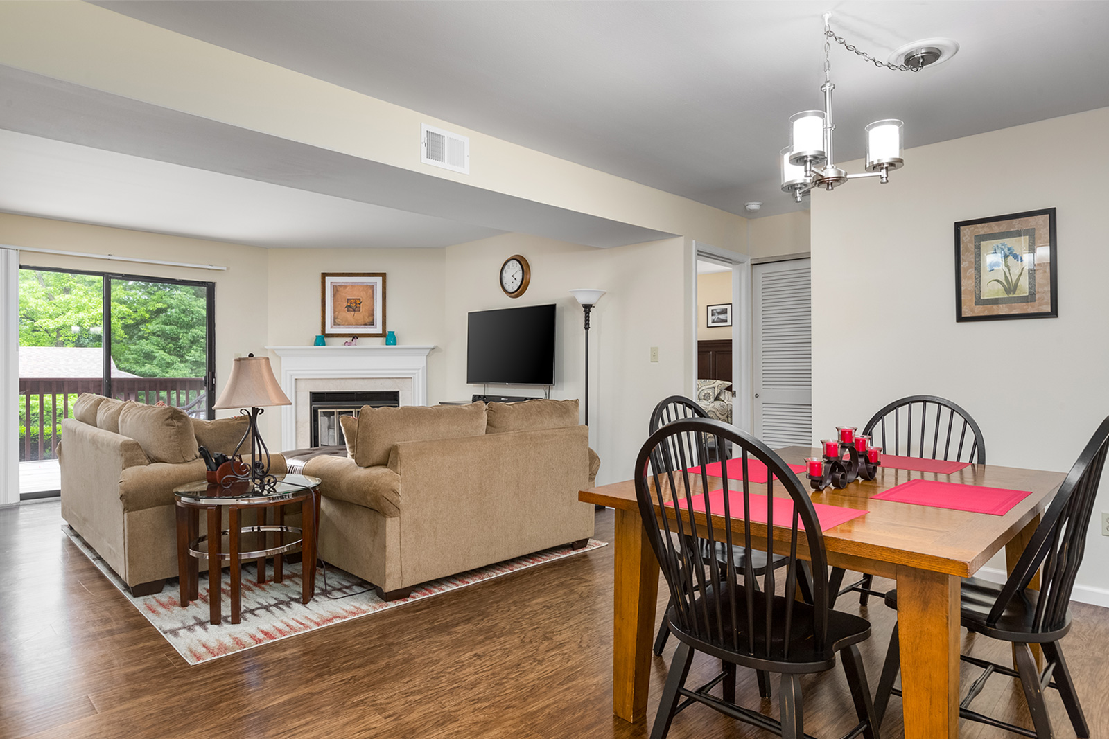 A dining room that leads into a living room at Chesterfield Village Apartments