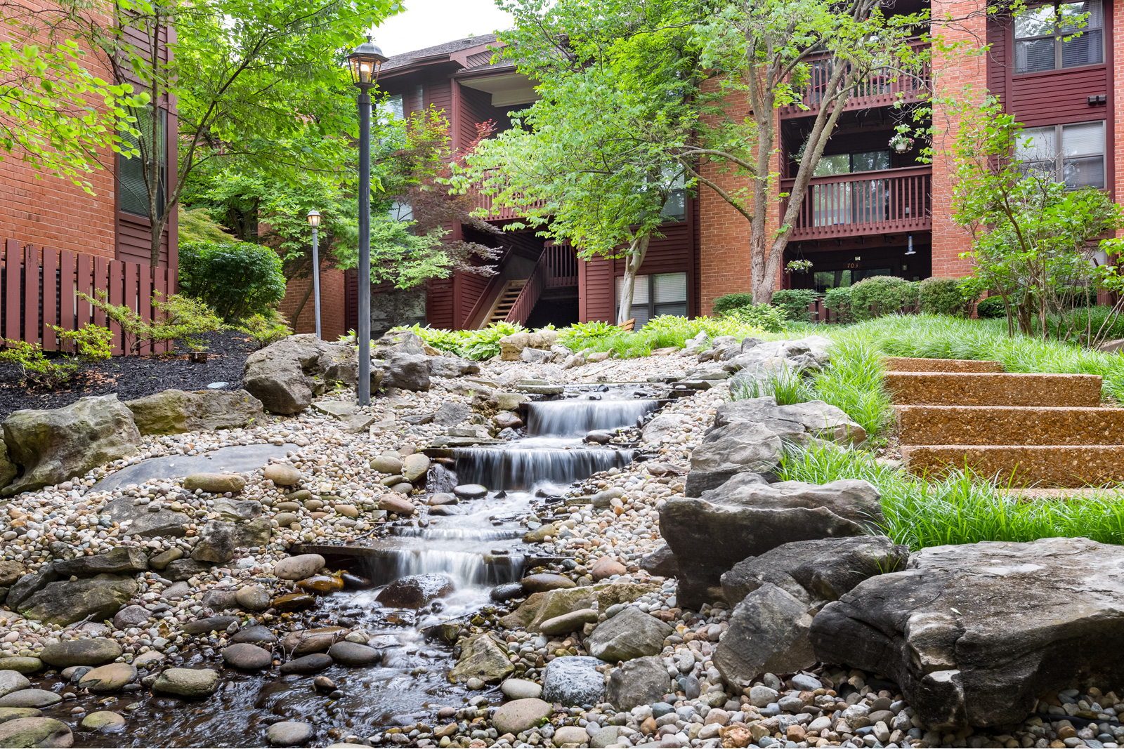 A babbling brook and apartments at Chesterfield Village Apartments