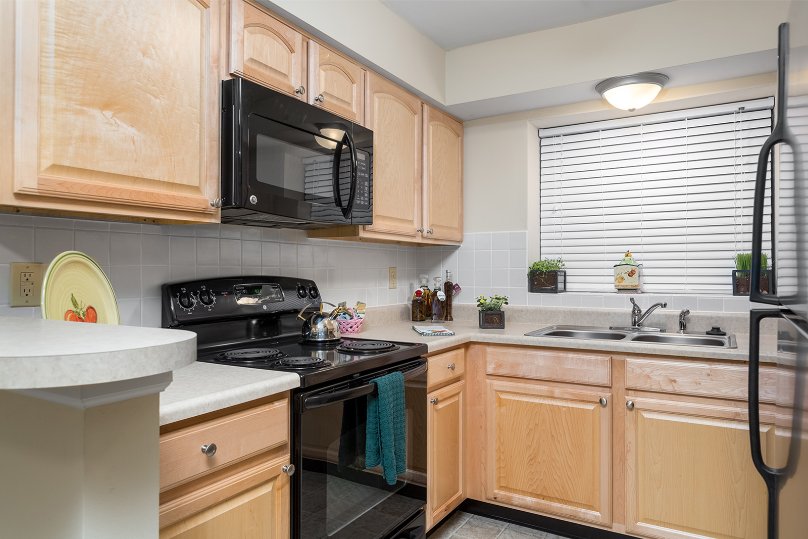 A kitchen at Chesterfield Village Apartments