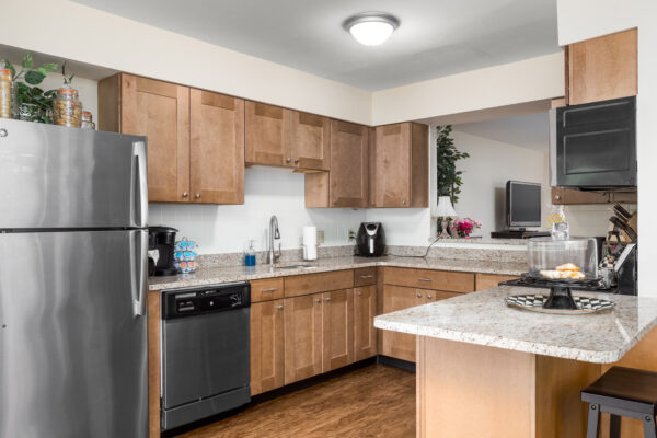 A marble kitchen countertop with views into other rooms at Chesterfield Village Apartments
