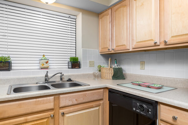 A kitchen countertop with a sink at Chesterfield Village Apartments