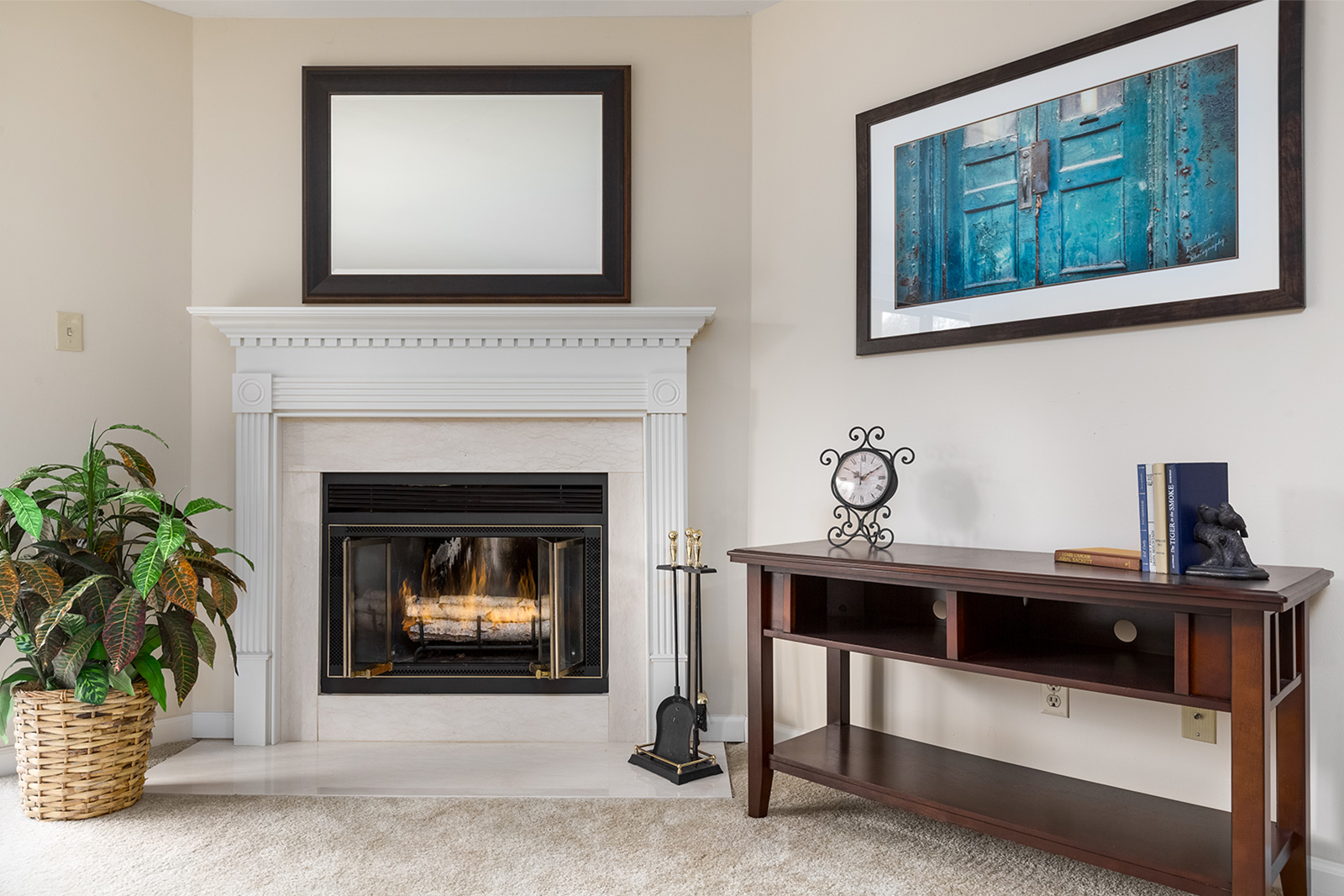 A living room fireplace and mantle at Chesterfield Village Apartments