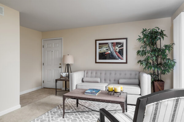 The entry way to a living room at Chesterfield Village Apartments