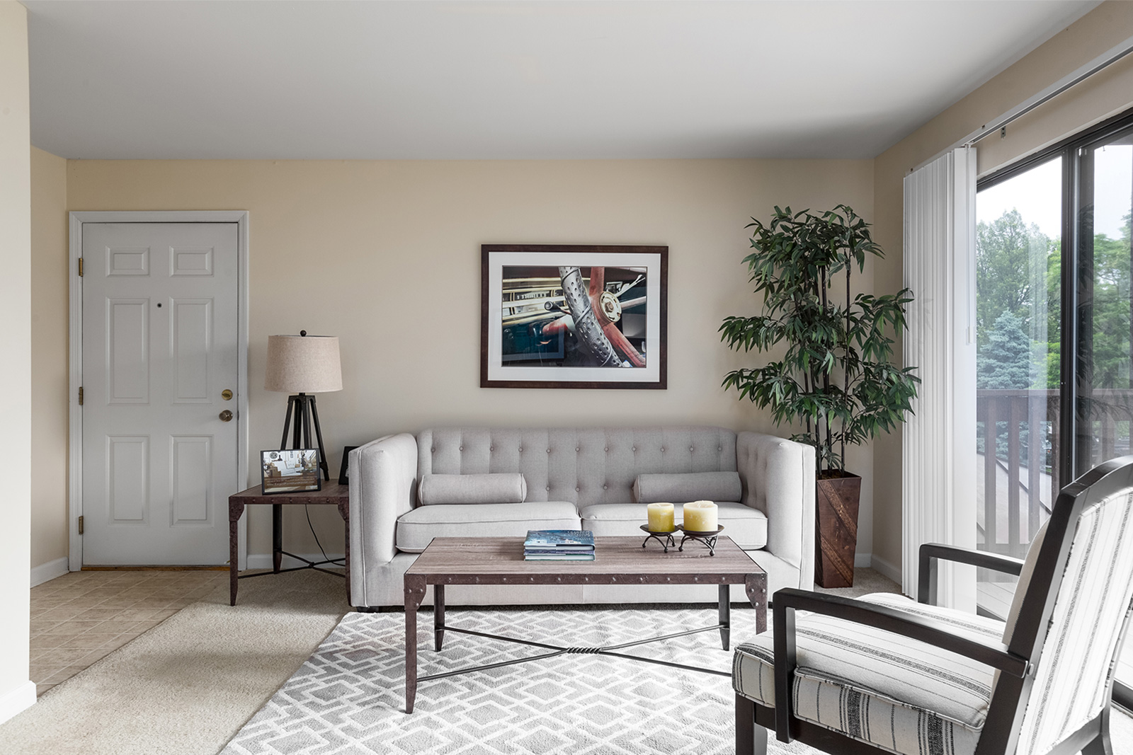 A living room and entry way at Chesterfield Village Apartments