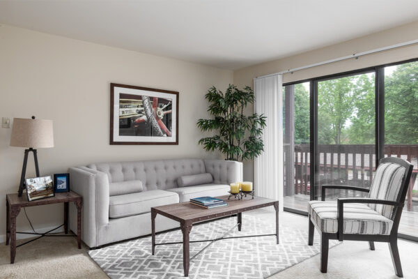 A living room with a deck at Chesterfield Village Apartments