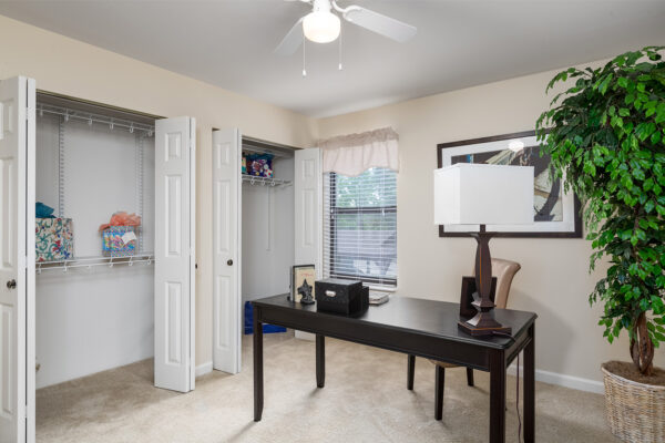 An office with open closets at Chesterfield Village Apartments