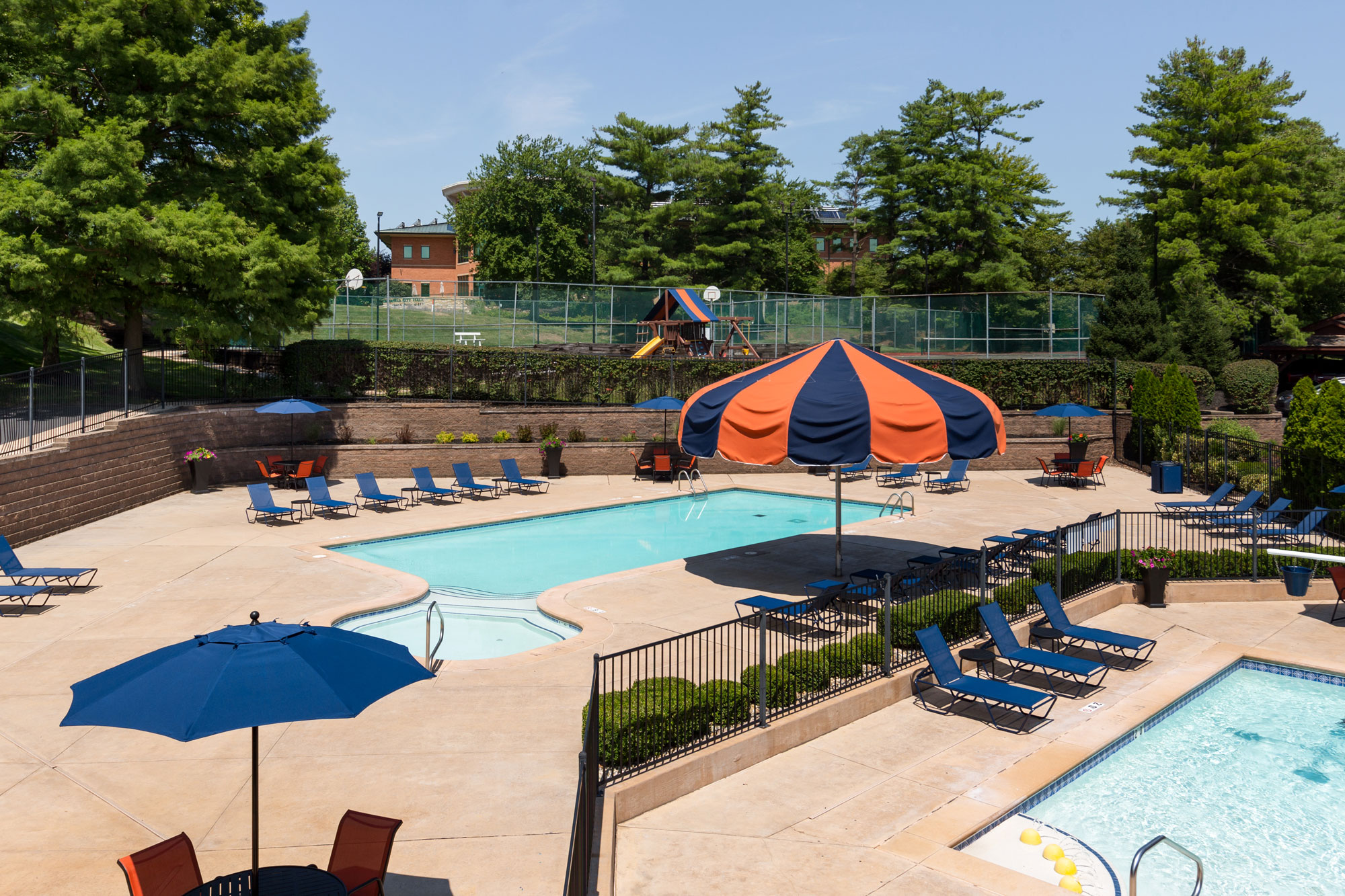 The Chesterfield Village Apartments clubhouse with a view of both pools