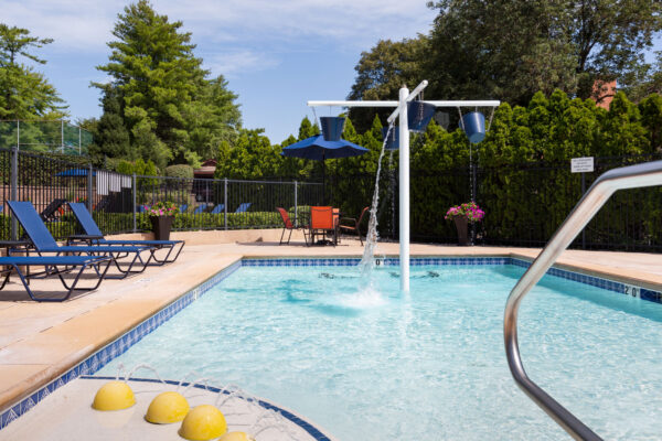 the kiddie pool with buckets dumping water at Chesterfield Village Apartments