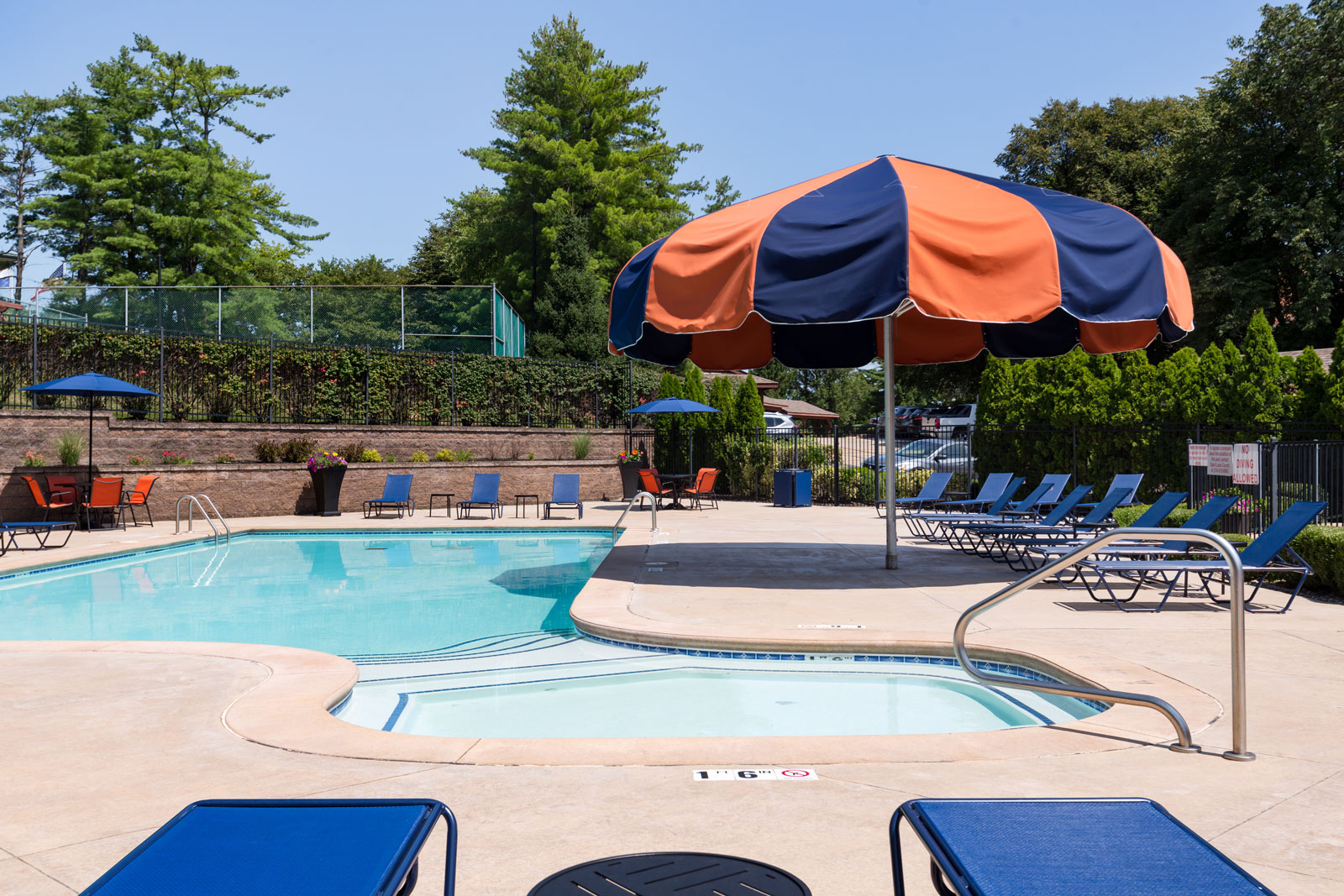A view of the large umbrella near the pool at Chesterfield Village Apartments