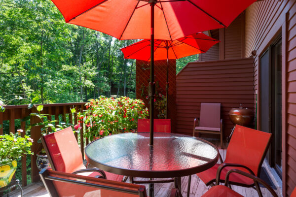 A deck patio with an outdoor view at Chesterfield Village Apartments