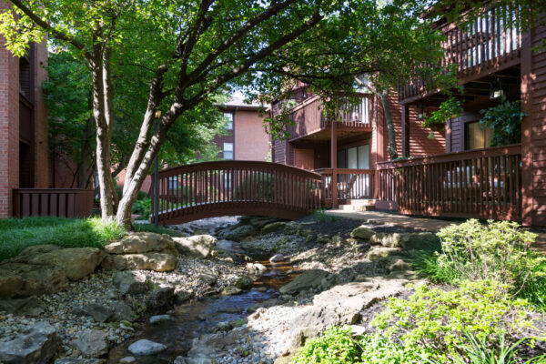 A bridge over a babbling brook at Chesterfield Village Apartments
