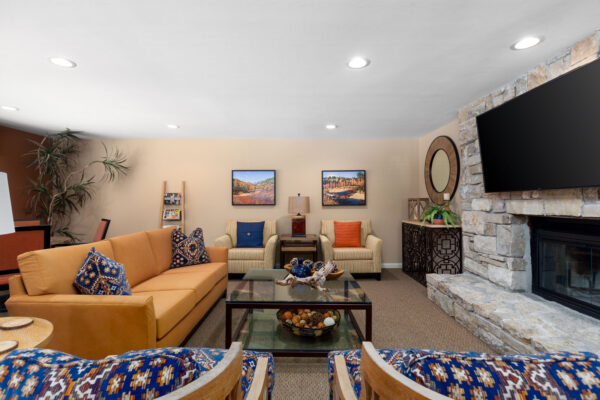 the fireplace hangout with chairs and a sofa at Chesterfield Village Apartments