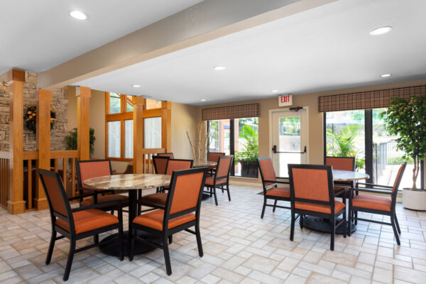 The dining and meeting tables in the clubhouse at Chesterfield Village Apartments