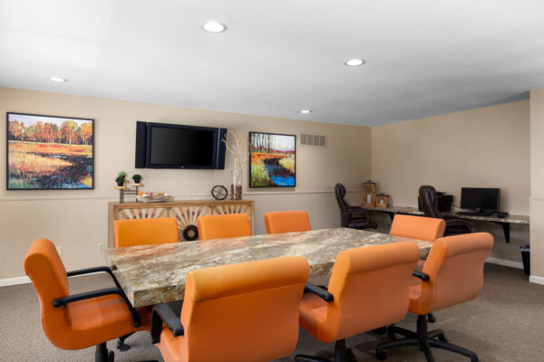 A conference table meeting room at Chesterfield Village Apartments