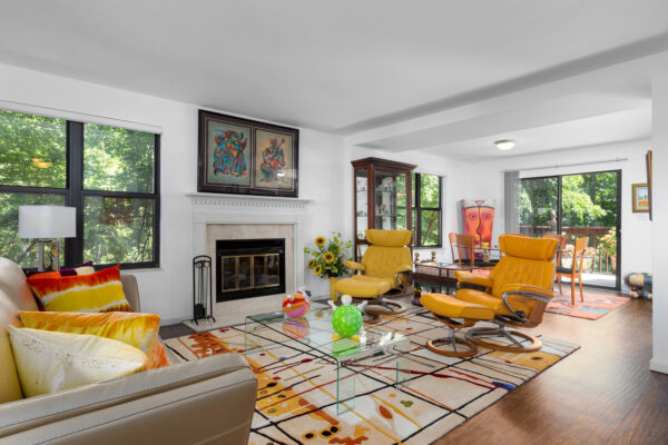 A living room with a fireplace at Chesterfield Village Apartments