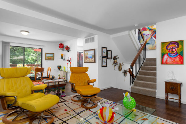 A living room with eclectic decor at Chesterfield Village Apartments
