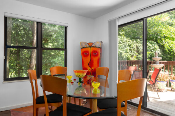A dining room table with an outdoors view at Chesterfield Village Apartments