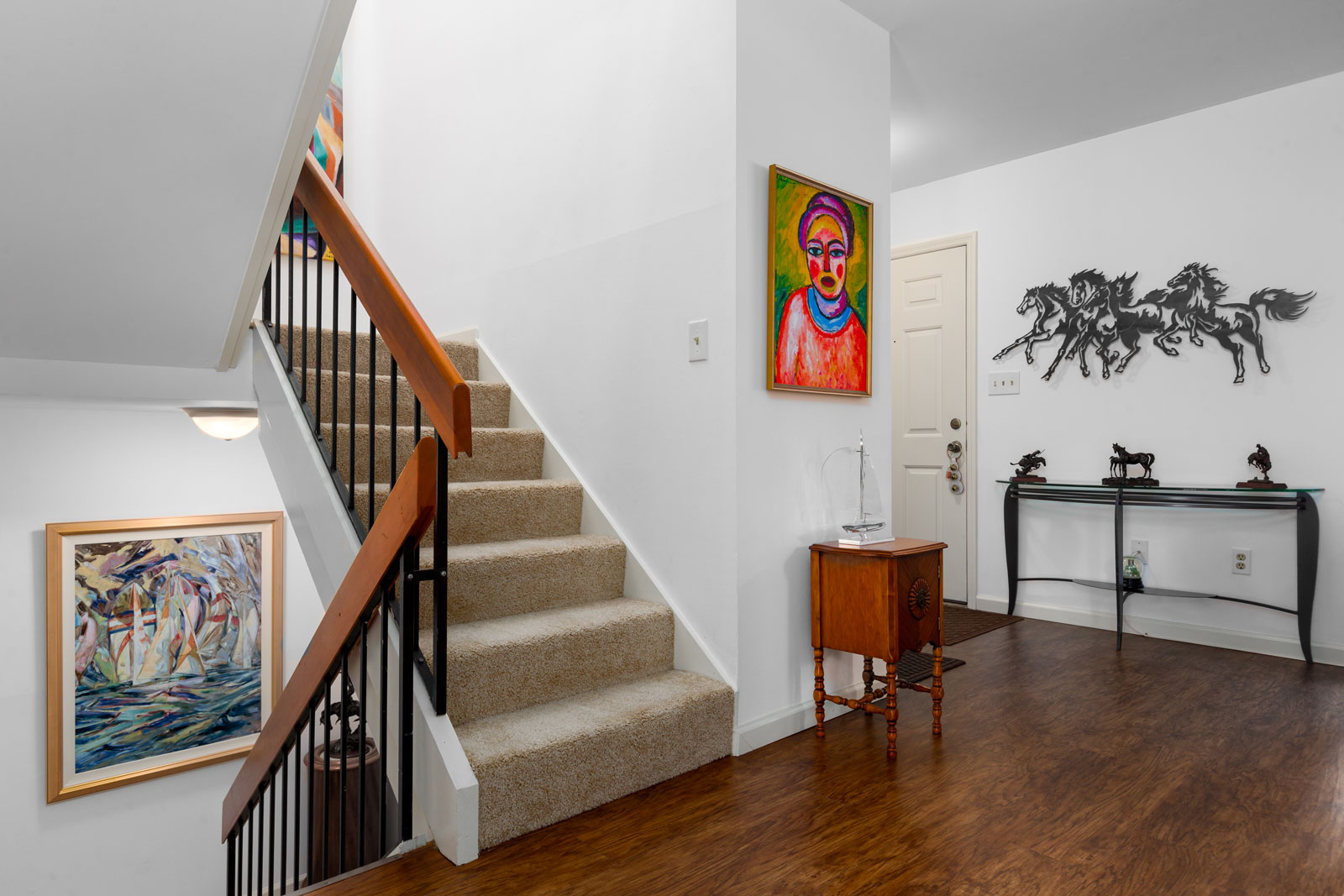 stairs leading up and down with a foyer in the background at Chesterfield Village Apartments