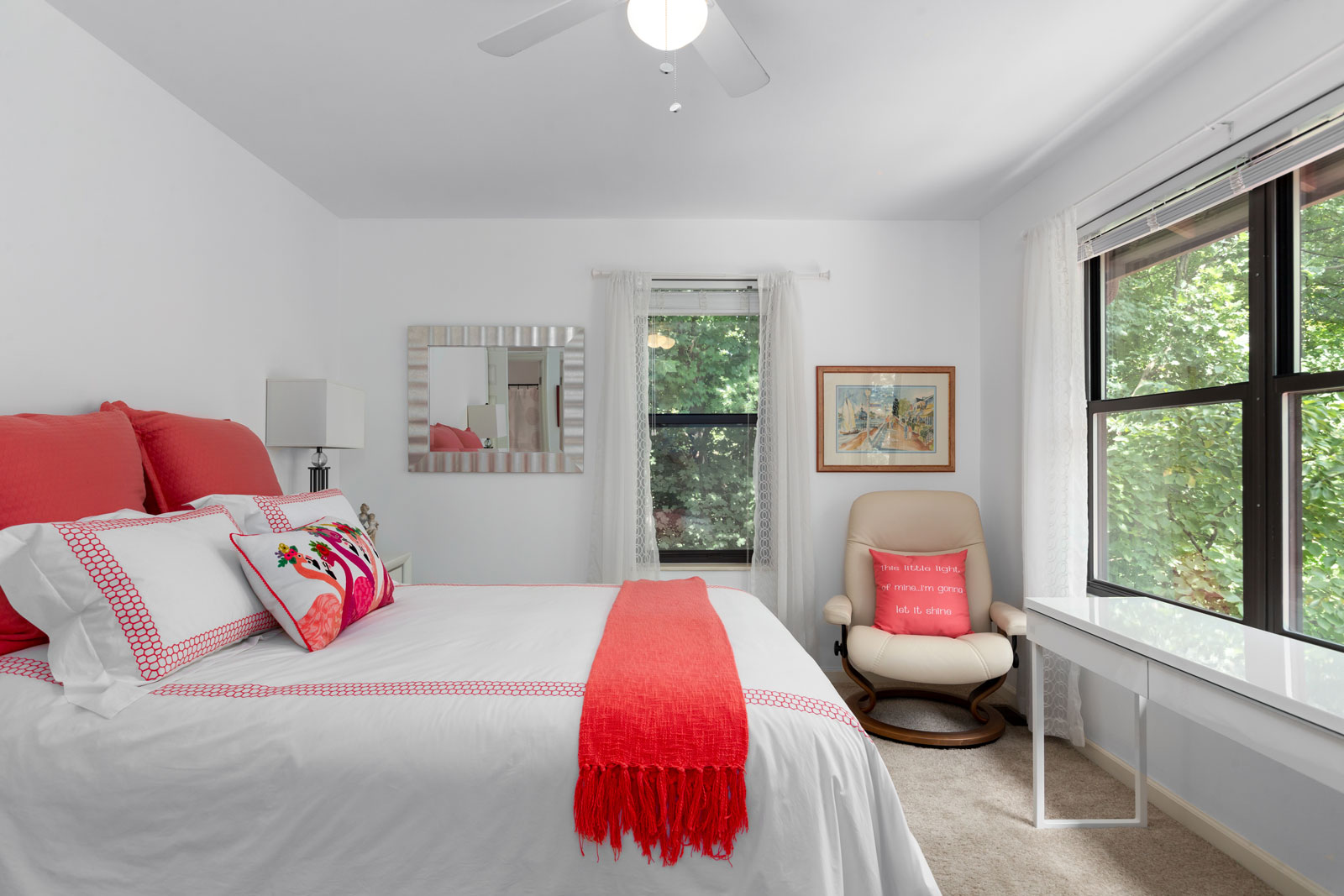 A bedroom with a bed and chair at Chesterfield Village Apartments