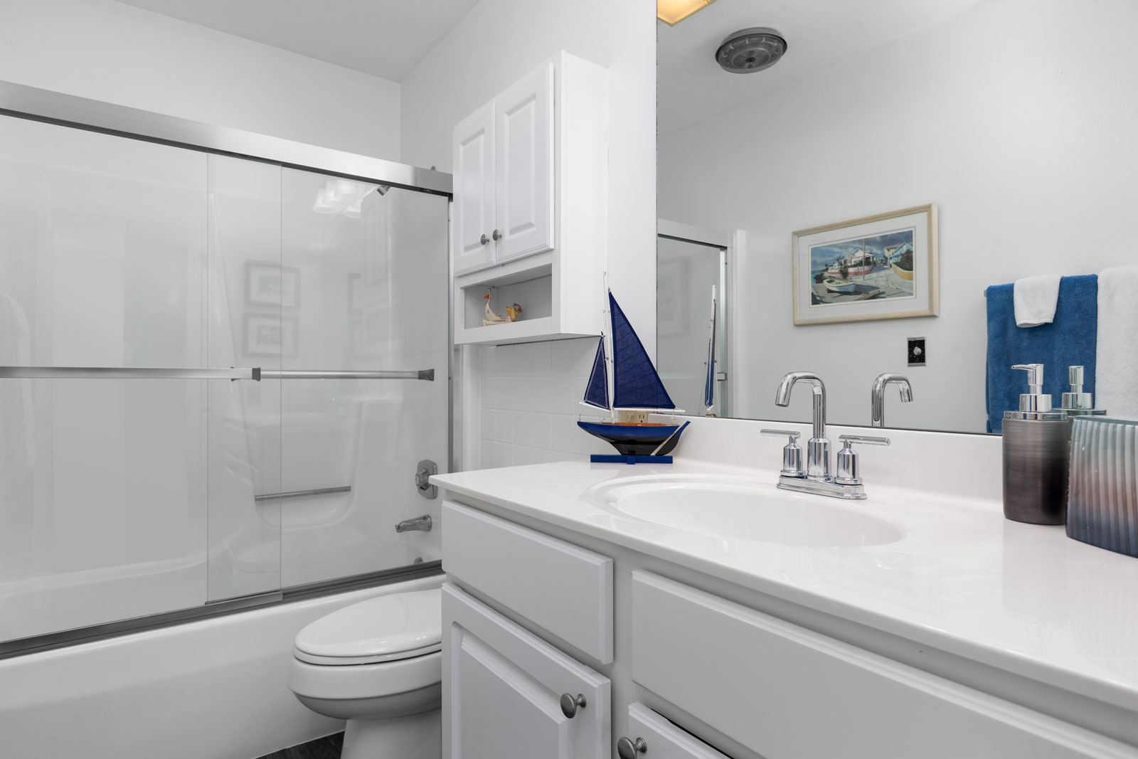 A bathroom with shower in background at Chesterfield Village Apartments