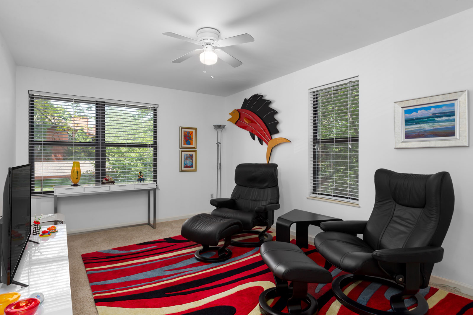 an alternate angle of a room with chairs and a television at Chesterfield Village Apartments