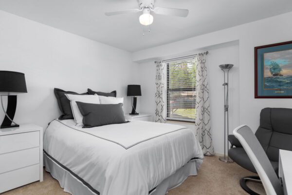 A bed and night stands Chesterfield Village Apartments