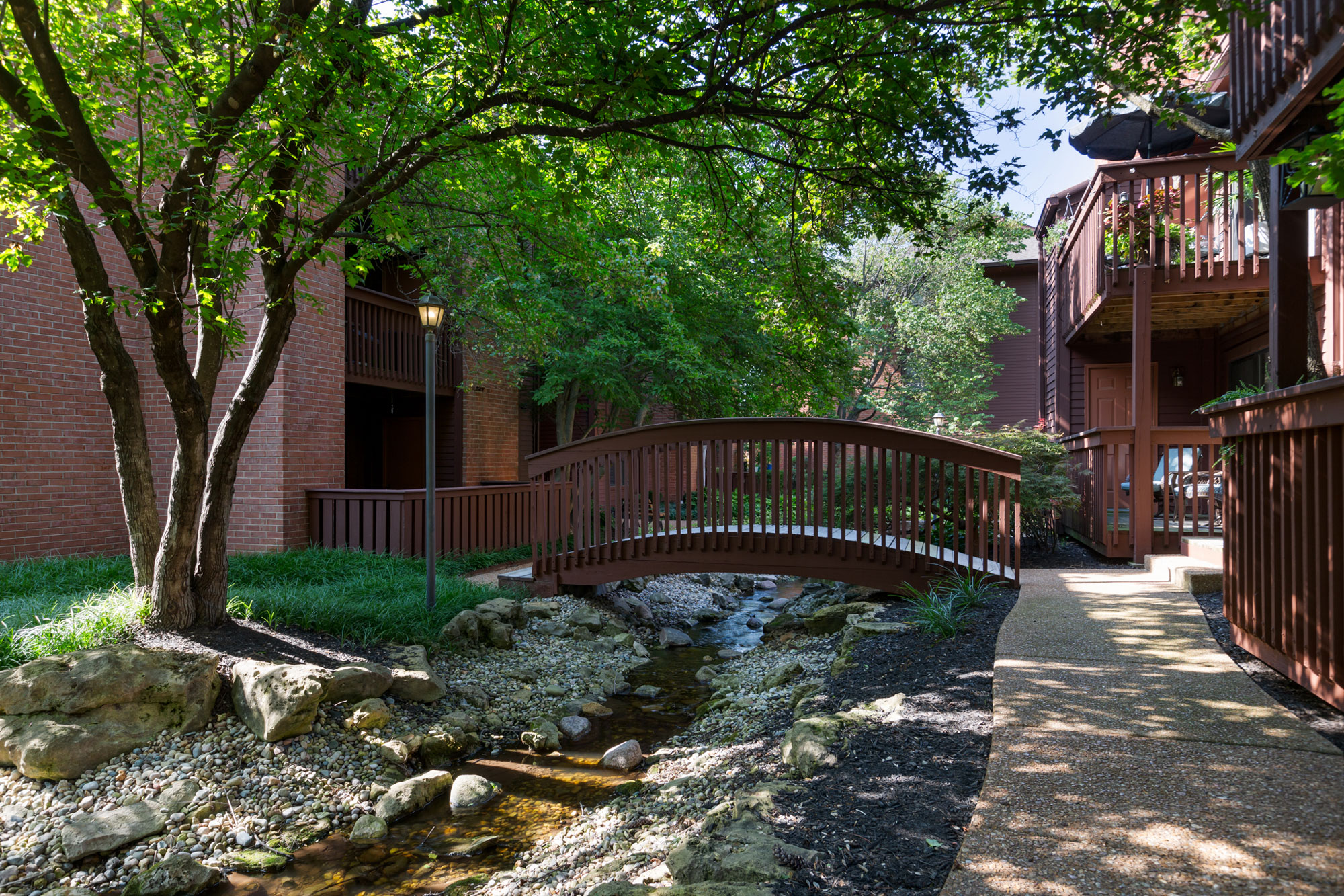 Bridge at Chesterfield Villages with wooded coverage