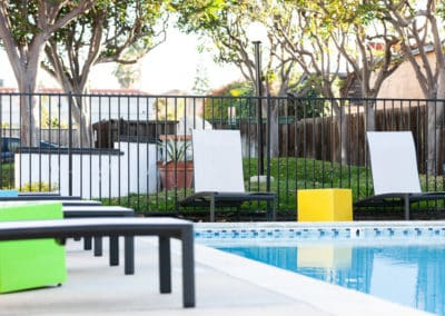 Swimming pool and poolside recliners
