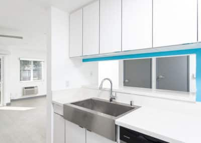 White kitchen with silver sink and cabinets
