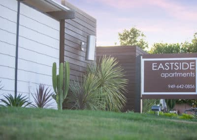Eastside Apartments Sign on grassy yard next to apartments