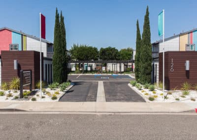 Entrance to the Eastside Apartment Homes with plants and Trees