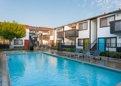 Pool surrounded by apartments