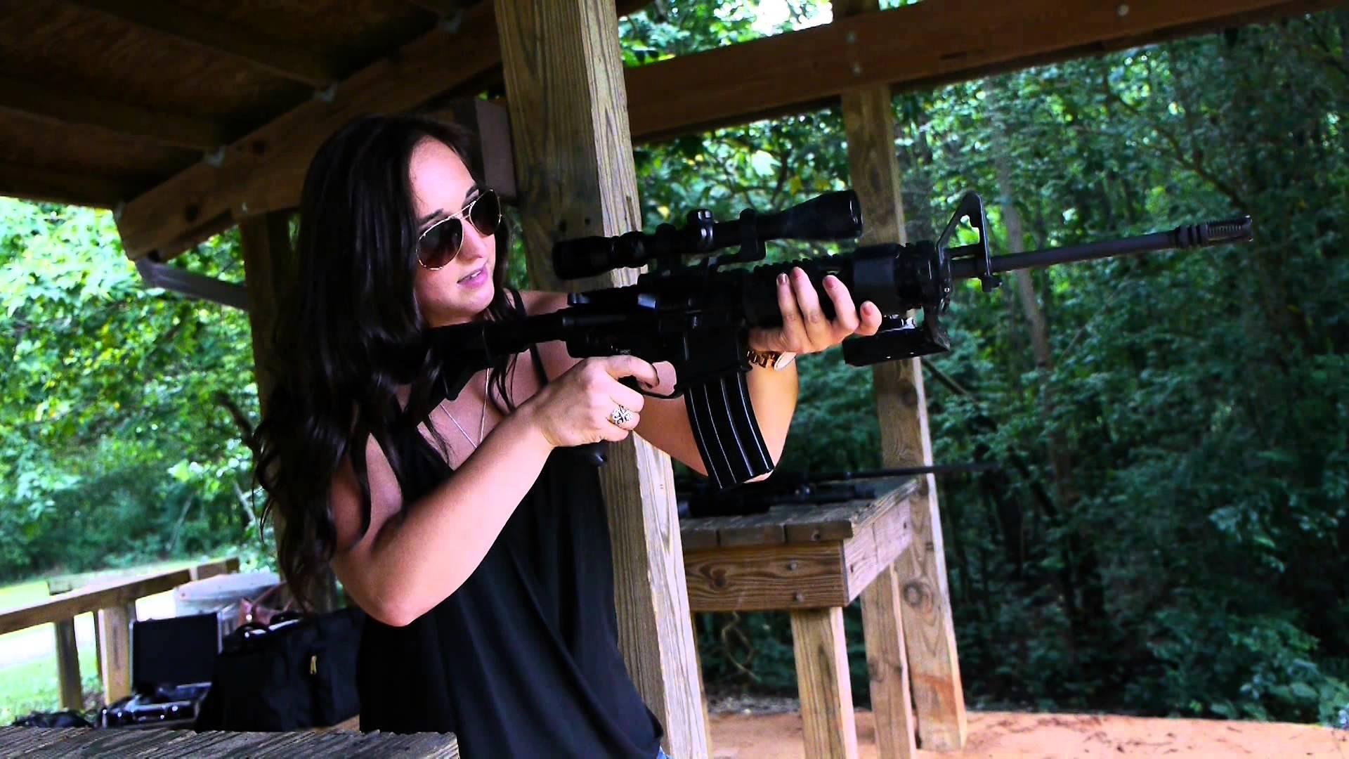 Paige Shooting a Del-Ton AR-15 Rifle