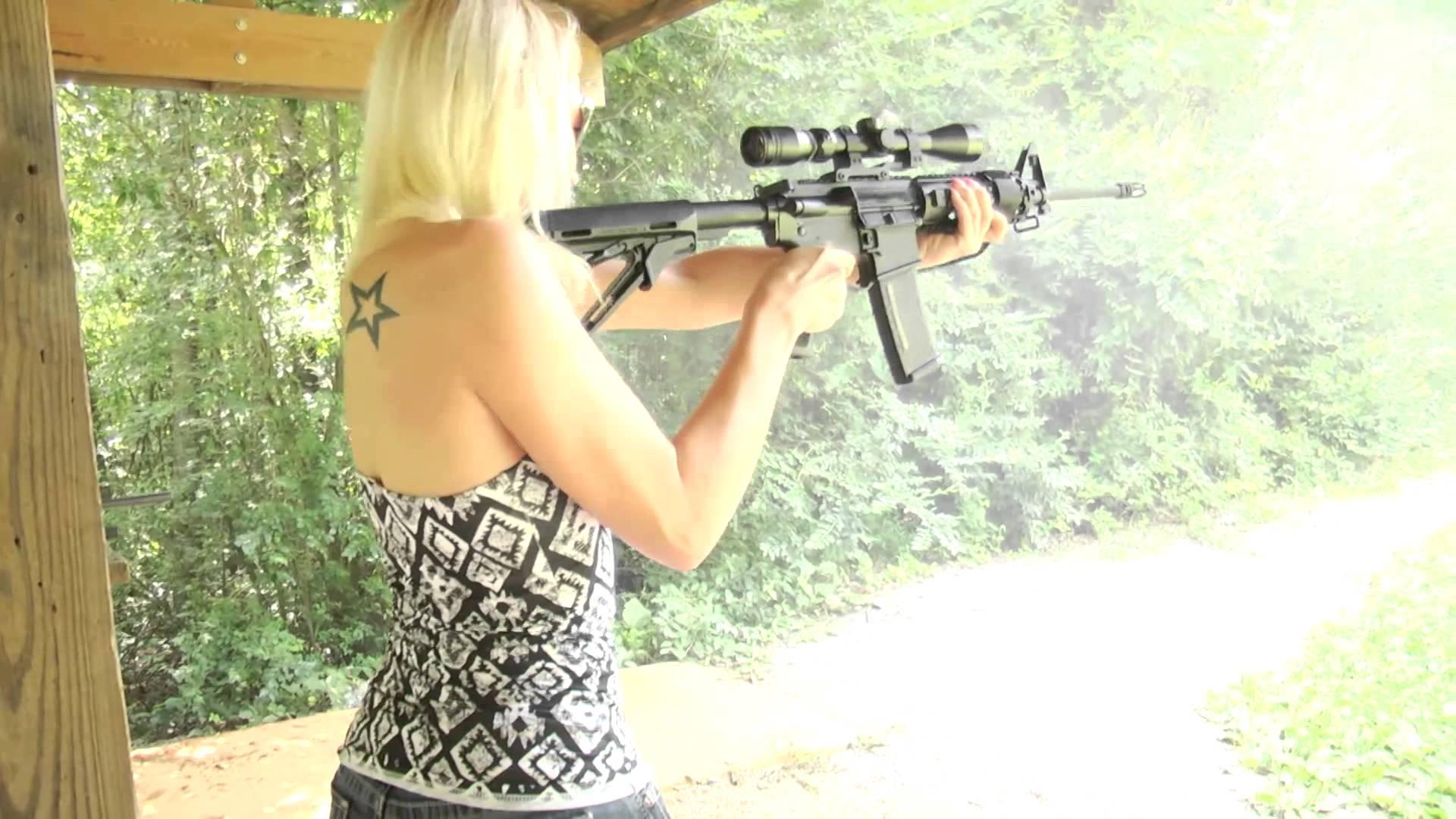 Shannon Shooting a Del-Ton AR-15 Rifle