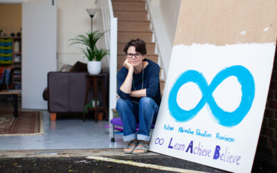 Dee Nic Stiric, Founder of Autism Champions, in their new unit with a LAB sign next to her