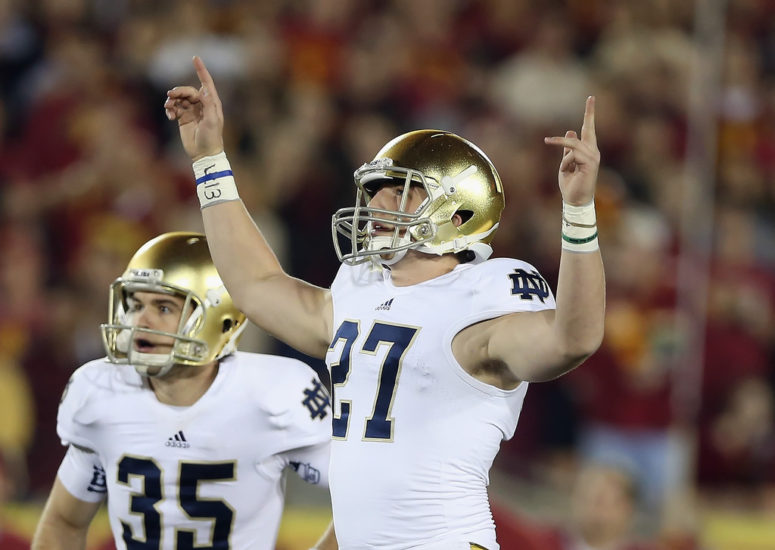 No. 1 Notre Dame beat USC, books national title game slot