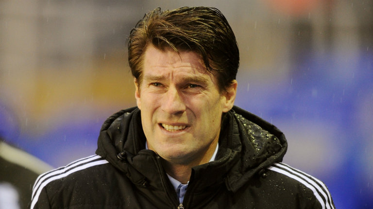 Swansea City part company with manager Michael Laudrup