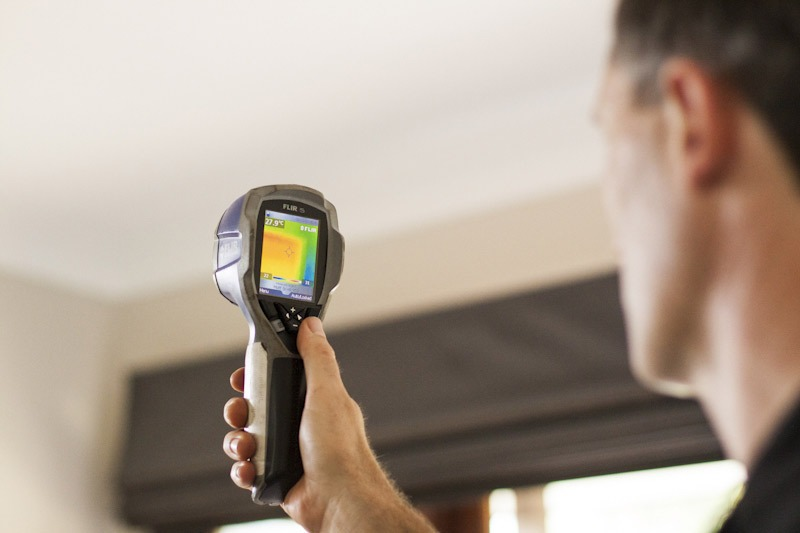 Five Star Claims Public Adjuster using an infrared camera