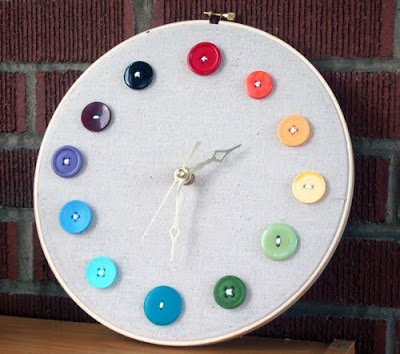 embroidery hoop clock with rainbow buttons