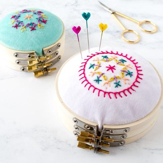 Pretty Embroidery Hoop Pincushion Tutorial with handstitched details.