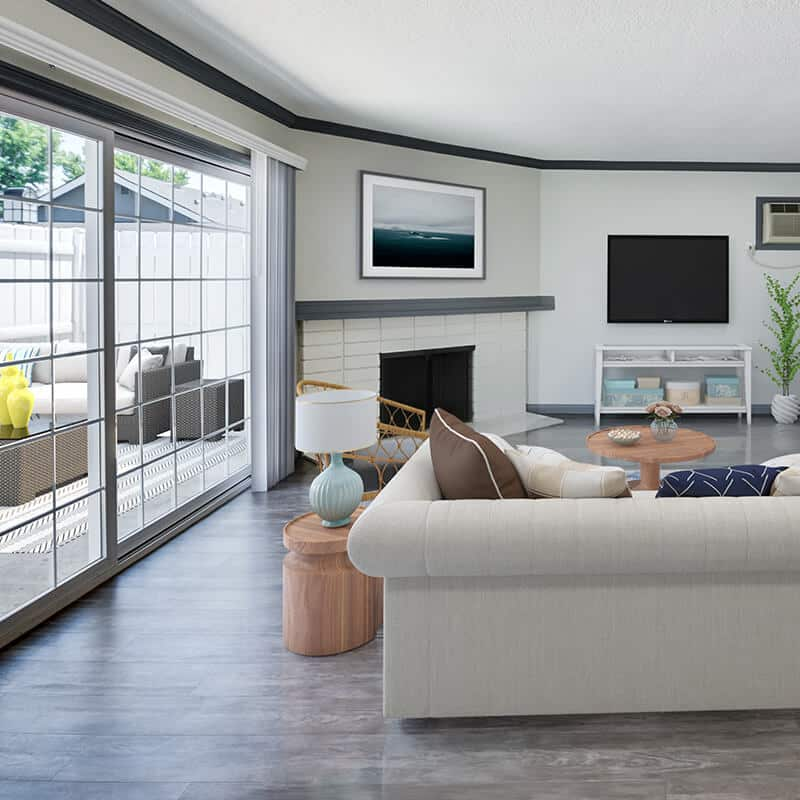 Furnished interior with fireplace and sliding doors to outside