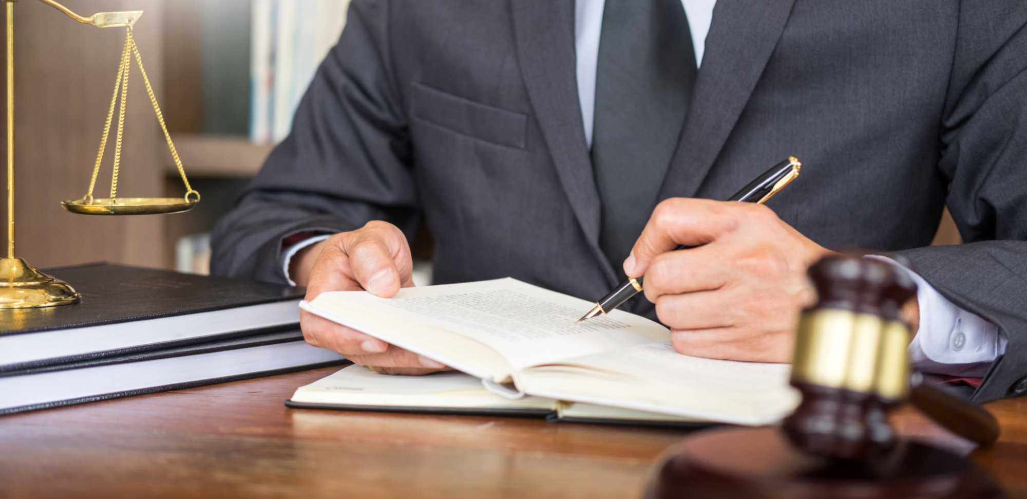 Attorney writing on a document