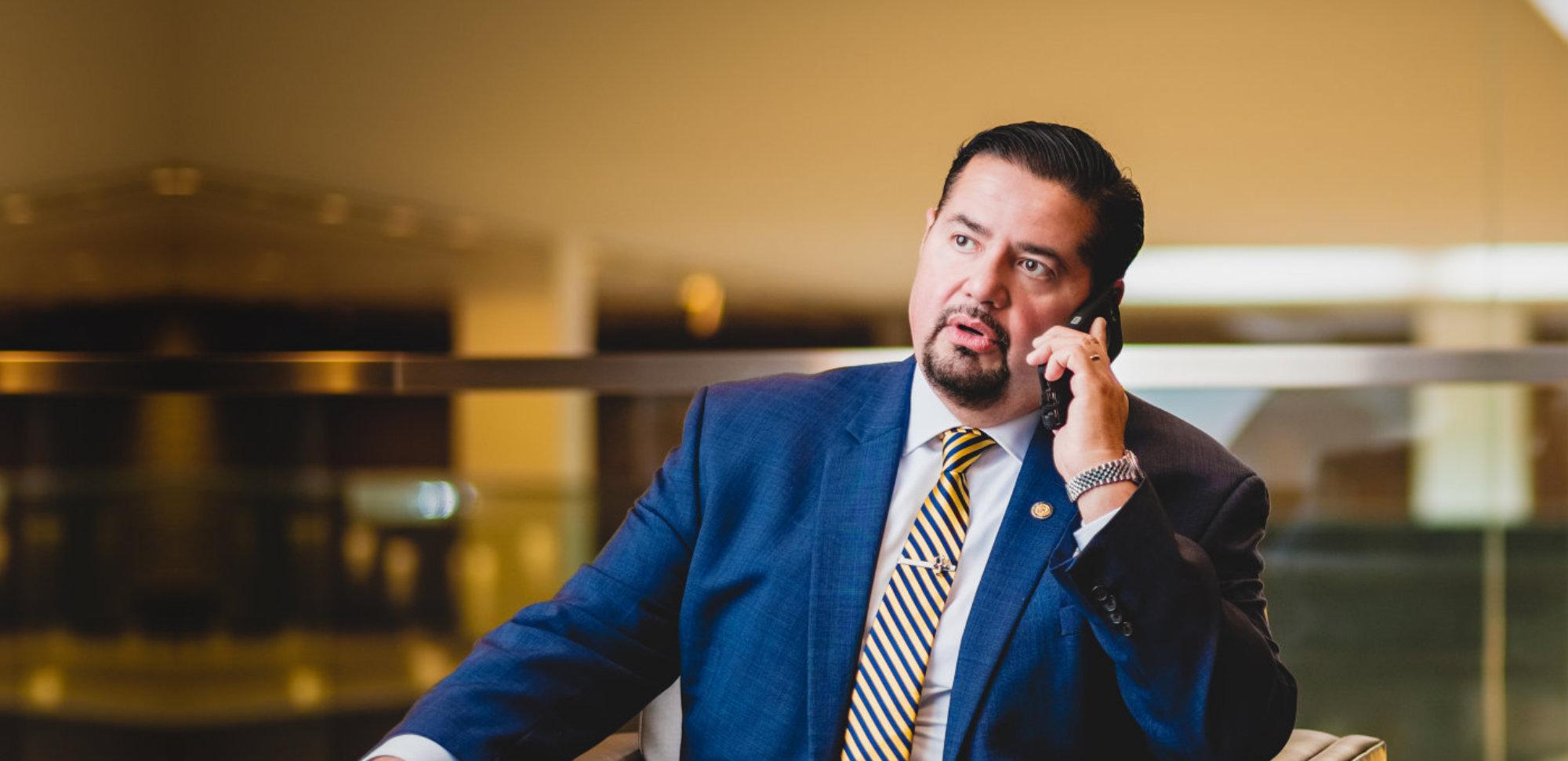 Attorney Joe Flores calling someone
