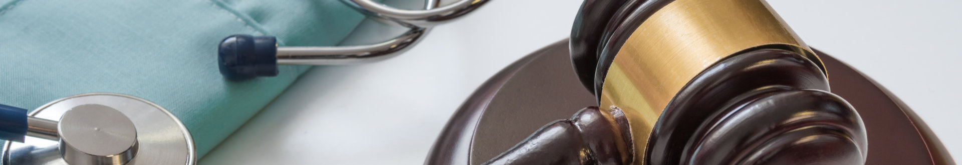 Gavel and stethoscope in background.