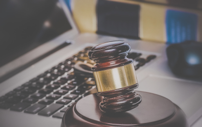 Law legal concept photo of gavel on computer