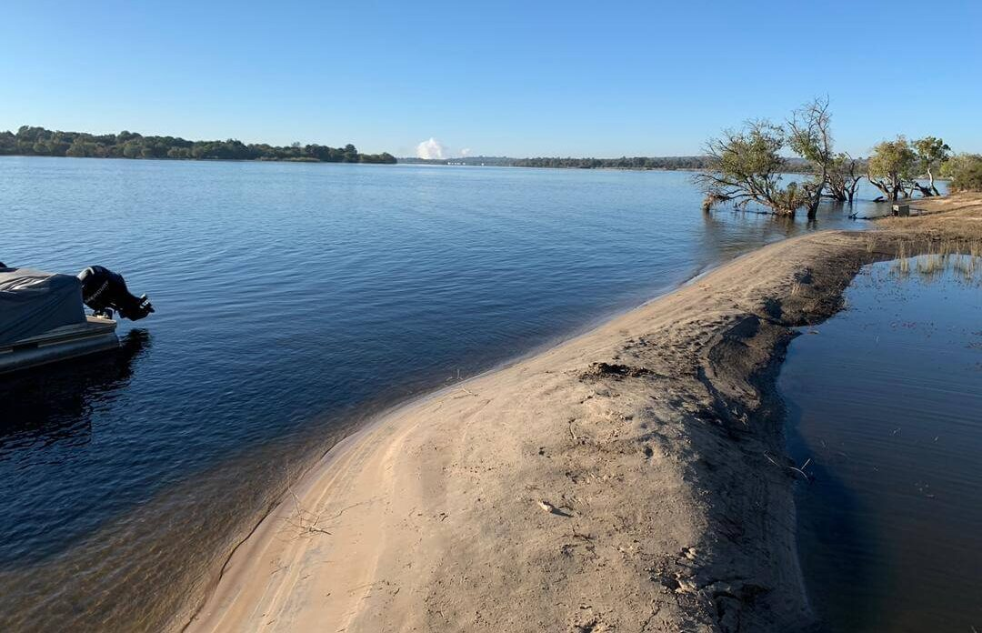 Sandbank infront of Victoria Falls River Lodge with view of the Falls Spray